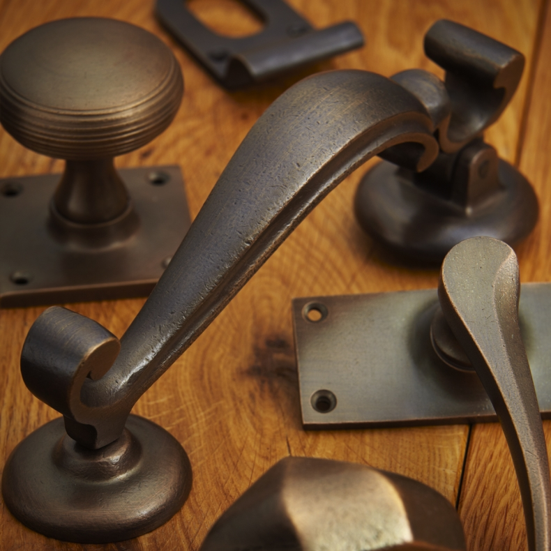 Tudor Bronze (TB) - Croft Lever Door Handle On A Round Rose Grace Range 7070 Brass