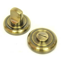Bathroom Door Turn Knob with a Radius Edge Rose  - Antique Brass Finish